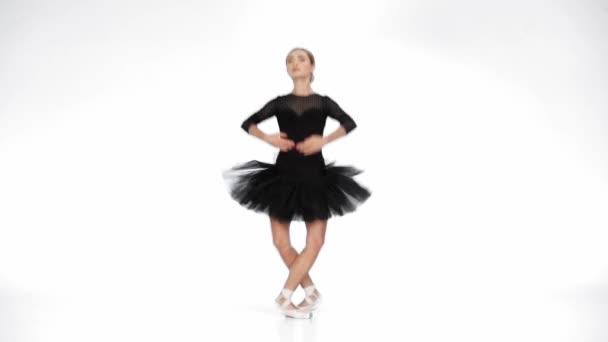 Elegant ballerina performing classical ballet moves on white background