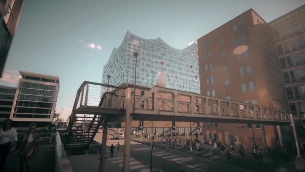 HAMBURG, GERMANY - JUNE 30, 2018: The famous new concert hall in Hamburg called Elbphilharmonie. Walk along a street in the central area of Hamburg. Steadicam footage.