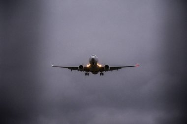Plane flying in the stormy sky