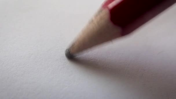 Pencil signature on white blank sheet of paper. Super macro.