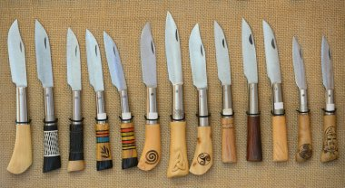 hunting knives arranged in a row close-up