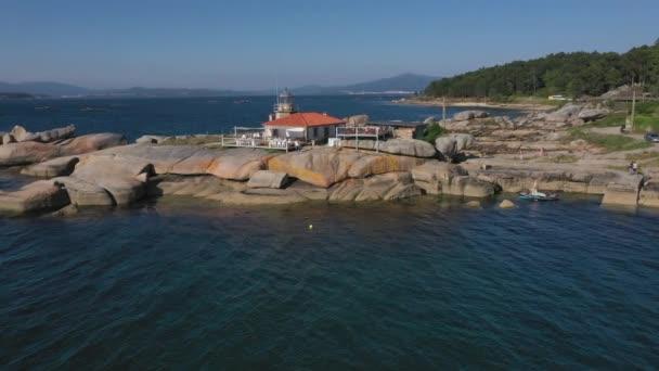 lighthouse on a cliff on the island Arousa, Galicia, Spain, 4k