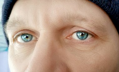 The penetrating gaze of a man. Tired eyes. Old brutal look of a man