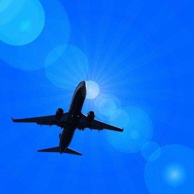 dark silhouette of airplane flying in sky