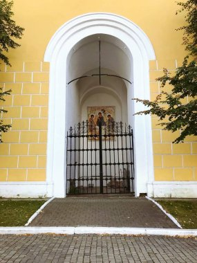 Russia, Kolomna, August 2020: entrance to the bell Tower of the Novo-Golutvin monastery in Kolomna. A door with an icon to a Christian Church.