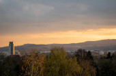 Beautiful autumn sunset with orange sky over Radvan - part of Banska Bystrica, Slovakia. View on office building.