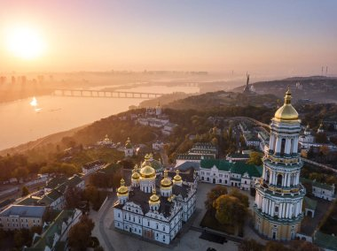 Most inetersting places of Kiyv Ukraine. Kiev Pechersk Lavra. Aerial drone photo. View to rider Dnipro and The Motherland Monument. Fog and sunrise light