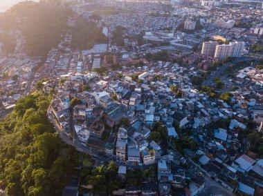 Rio de Janeiro city aerial view. Favelas hills. Sunset backlight.