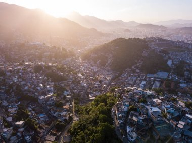 Rio de Janeiro city aerial view. Brazil. Houses on hills. Favela. Beautiful romantic sunset backlight