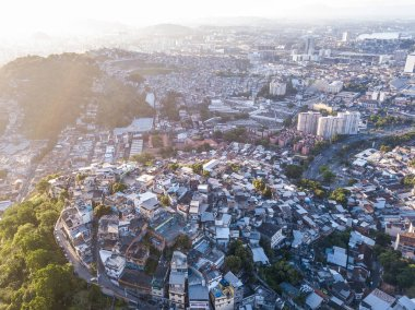 favelas house on the hills. Aerial photo of city Rio de Janeiro Brazil. narrow streets of the poor . Beautiful sunset backlight