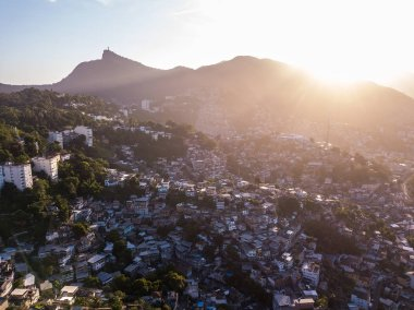 Sunset in Rio de Janeiro Brazil. Aerial photo to houses on hills and mountains. Beautiful sunset backlight. Evening in favela