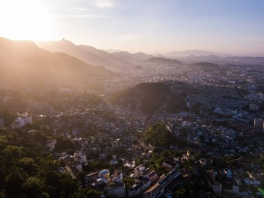 Amazing Rio de Janeiro sunset backlight. Favela located on hills houses. area of city from the air. Brazil