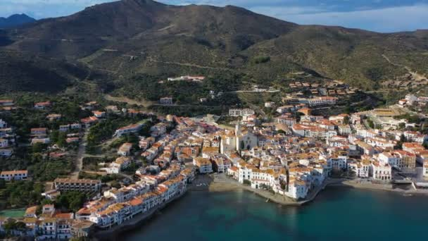 Cadaques amazing spanish town by the sea. Punta de sa Costa. Video footage. Aerial drone camera moves away from the beach at sea. view to mountains landscape and the city
