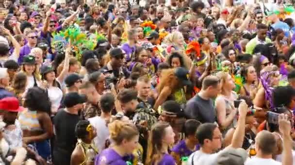 Berlin, Germany - June 9, 2019: Carnival of Cultures Parade Karneval der Kulturen Umzug - a multicultural music festival in Kreuzberg. a crowd of diverse nationalities walking down the street. Video