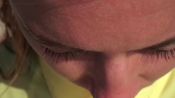 Close-up of a girl s head, hairs are seen in detail, skin structure, hair, eyebrows, eyes, nose, pores, eyelashes