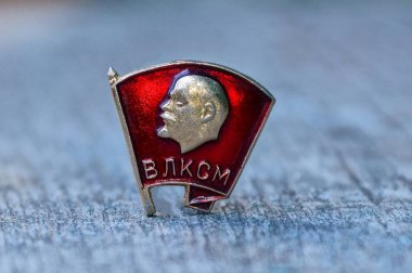 one red komsomol icon on a gray table