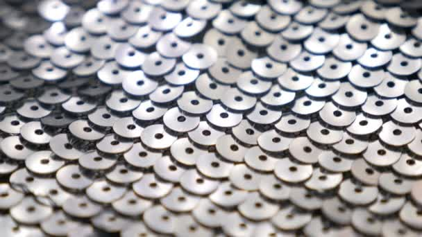 seamless textile with shiny grey sequins, close-up