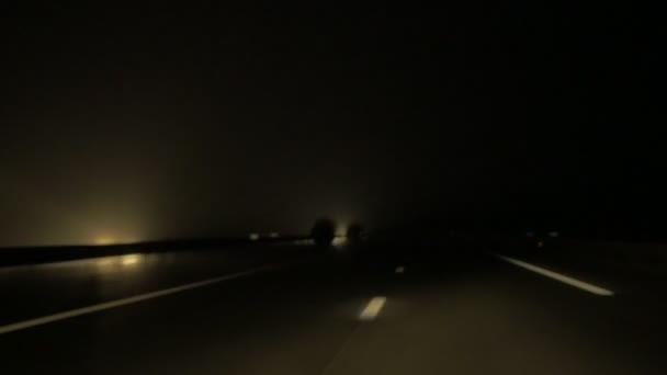 Highway drive with asphalt pavement markings at night
