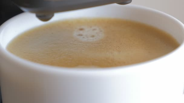 Fresh made espresso coffee froth in cup