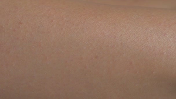 female tanned legs after exposing them to sun, close-up