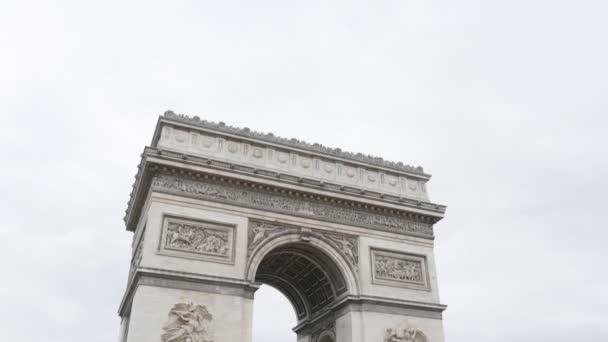 Great France and Paris famous symbol Arc de Triomphe on cloudy sky background, Paris, France