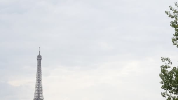 French river Seine and world wide recognizable famous French Eiffel tower in front of cloudy sky, Paris, France