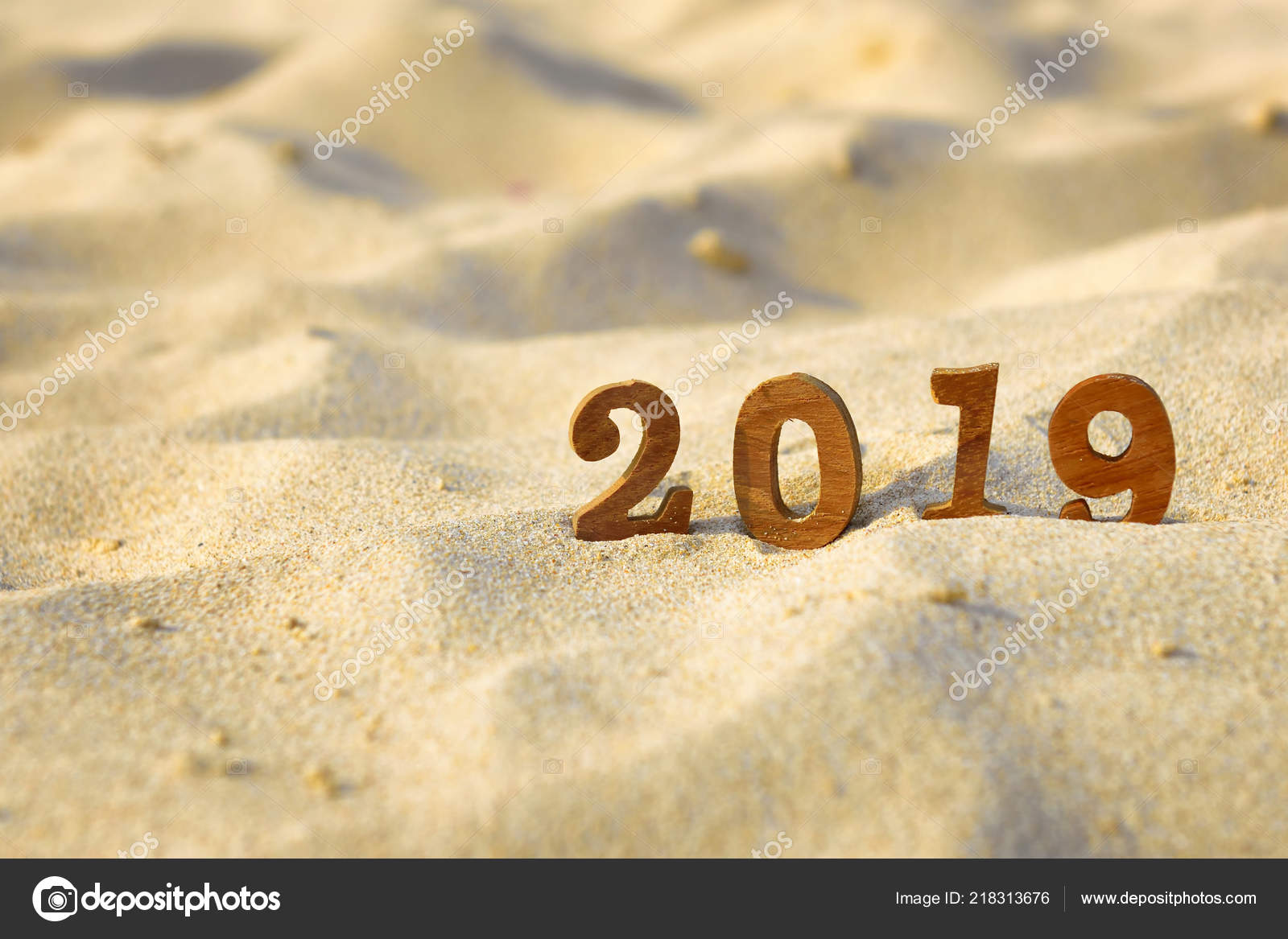 wooden number 2019 sand beach happy new year concept happy stock photo