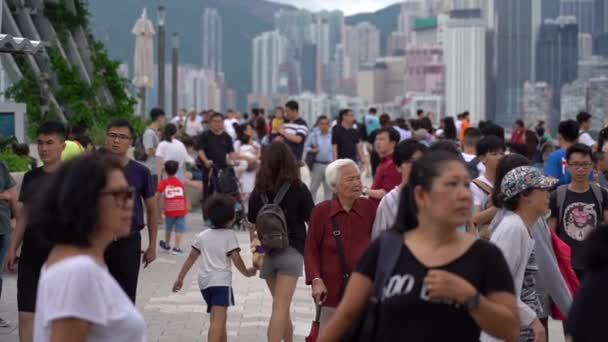Hong Kong, China, June 02, 2019: Slow Motion of Tourists visiting the Avenue of the Stars which is one of the most visited tourist attractions in Hong Kong.