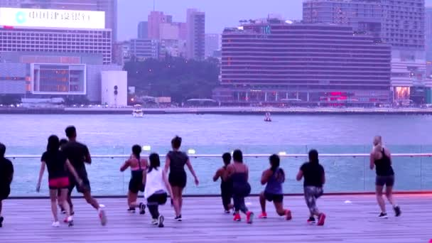 Hong Kong, China, 09 July, 2019: A group of Sporty people doing workout in the Tamar Park