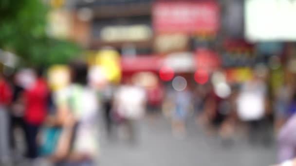Homályos tömeg emberek Hong Kong elfoglalt crosswalk; Lassított mozgás