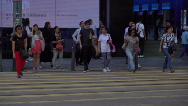 Hong Kong, China, 16 Oct 2019: Slow Motion of Busy streets of Central District in Hong Kong and Pedestrians walking over the zebra.