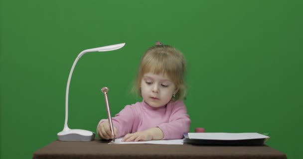 Girl drawing at the table. Education process. Three years old child. Chroma Key