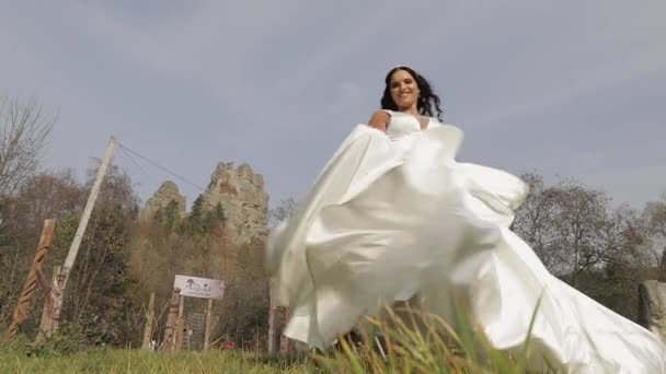 Beautiful and lovely bride in wedding dress and veil. Slow motion