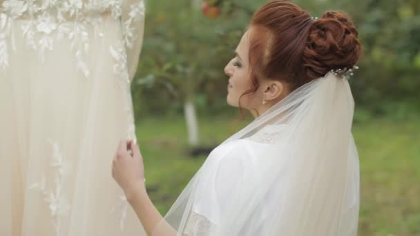 Beautiful and lovely bride in night gown and veil. Wedding dress. Slow motion