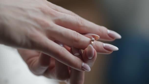 Elegant blonde bride wear beautiful engagement ring. Woman at wedding morning