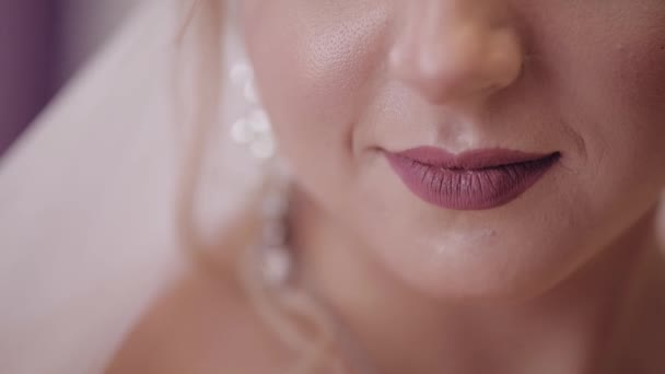 Beautiful and lovely bride. Close up shot of brides lips. Wedding morning