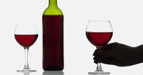 Glass with rose wine. Wine glasses with red wine against white background