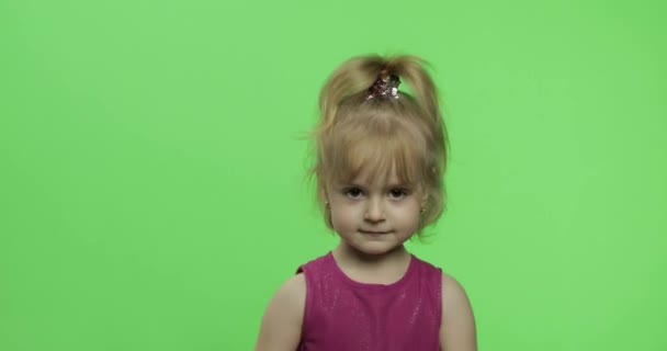 Girl in purple dress dancing. Happy four years old child. Chroma Key