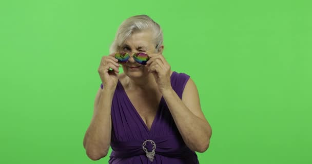 An elderly woman in sunglasses smiles. Old grandmother. Chroma key