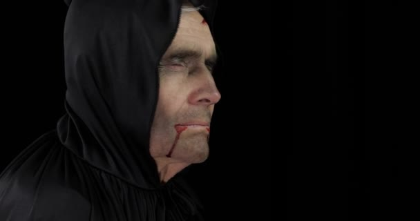 Old executioner Halloween makeup and costume. Elderly man with blood on his face