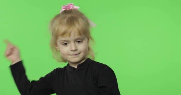 Pretty girl emotionally makes faces in black blouse. Portrait. Chroma Key