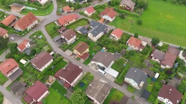 We can see a raised-relief map of the houses in the village. The countryside is green. Aerial shot.