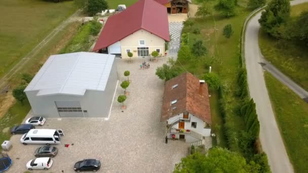 We can see three big buildings in the middle of the countryside. Aerial shot.