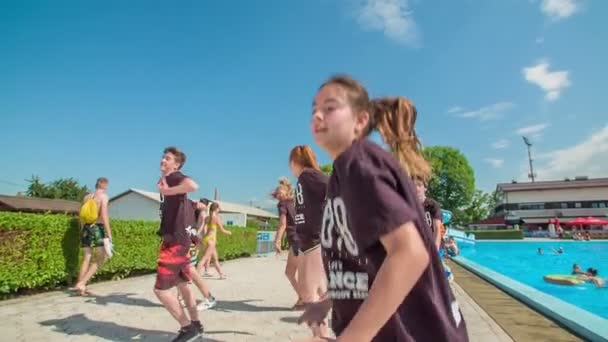 DOMZALE, SLOVENIA - 20. JUNE 2015  Youth is full of creative energy. They're dancing and having fun in a swimming resort.