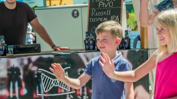 DOMZALE, SLOVENIA - 15. JUNE 2018  Kids are waving at a mascot and are giving it a high five.