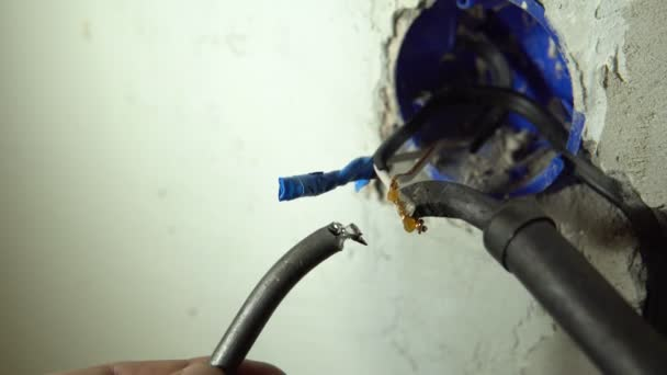 Close-up brazing of copper wires with a soldering iron using tin.