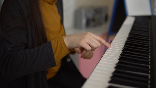 Hands of women play on the electronic synthesizer