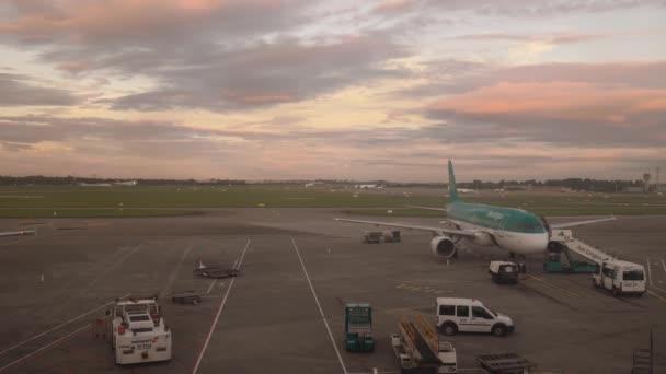 Plane waiting at gate in Dublin airport at dawn