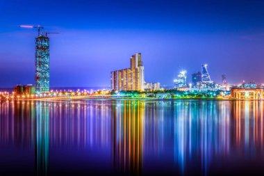 Panoramic view of glowing cityscape of Jeddah City at twilight, Saudi Arabia