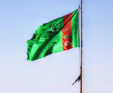 Turkmenistan flag waving in the blue sky